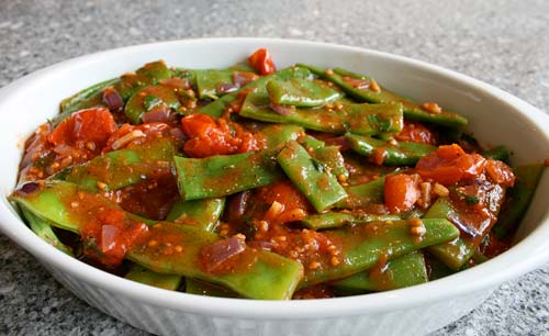 A spicy tomato sauce turns basic green beans into an extraordinary side dish.