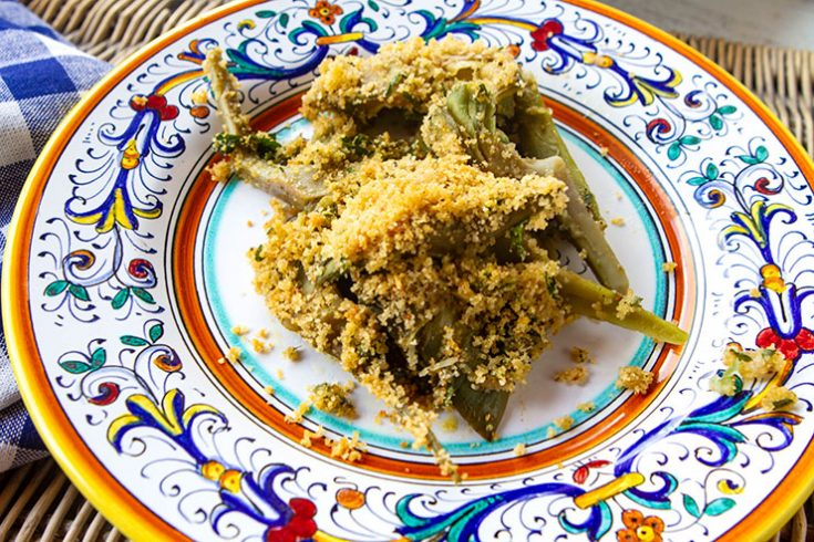 A baked version of artichokes topped with a cheese flavored crumb crust.