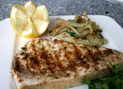 Swordfish steaks, lightly breaded and grilled as they do in Sicily.