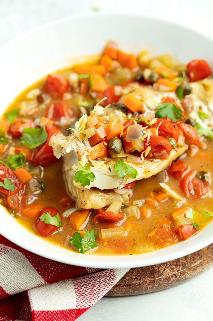 Cooking whitefish fillets in a broth keeps them very moist.