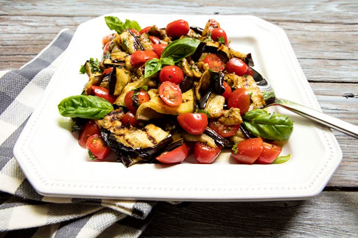 Grilled eggplant and sweet cherry tomatoes are a perfect match in this tasty salad.