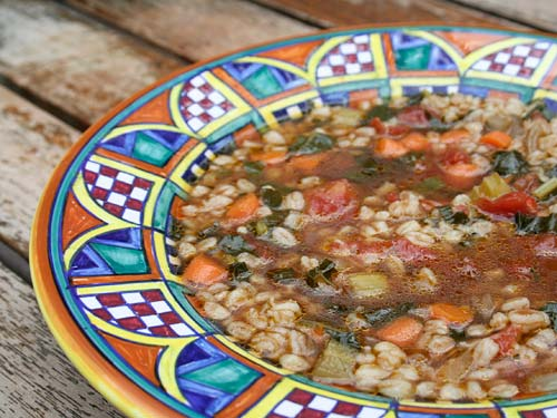 A country peasant soup using the ancient grain farro that can be found across Umbria. Use barley in place of farro if you cannot find it.