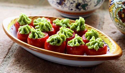 Fresh fava beans make a tasy filling for sweet cherry tomatoes in this colorful appetizer.