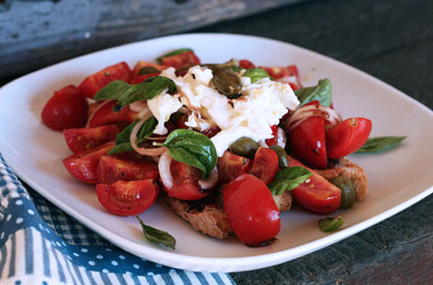 This salad has both the bite of spicy nduja, as well as creamy burrata cheese.