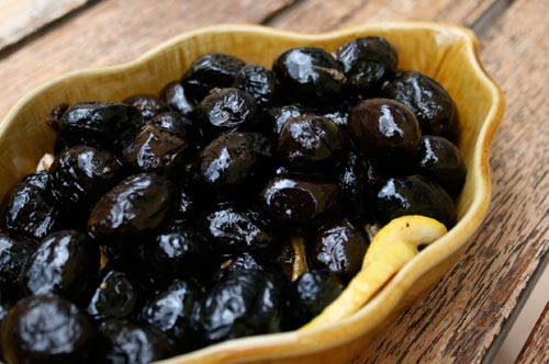 Fennel seeds and orange peel are used to flavor oil cured olives before they are baked.