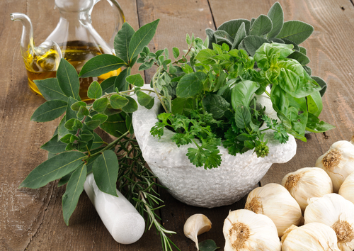 Cooking With Herbs In An Italian Kitchen