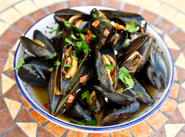 A spicy steamed mussel dish flavored with sopressata and sun-dried tomatoes.