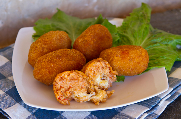 Crispy brown rice balls filled with cheese.