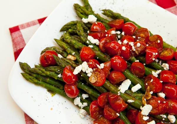 A vibrant mix of tomatoes and goat cheese tops tender blanched asparagus spears in this easy dish.