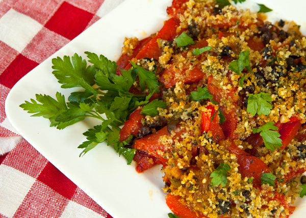 Tender roasted peepers topped with golden brown crumbs flavored with olives make a great option for the antipasti platter.