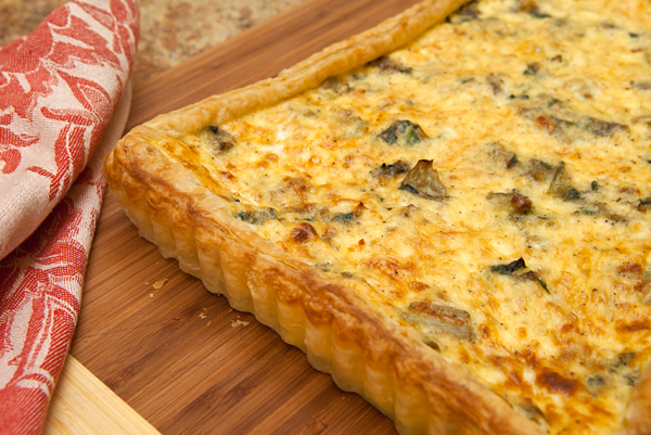 Store bought puff pastry makes this ricotta, spinach, and artichoke tart very easy to assemble.