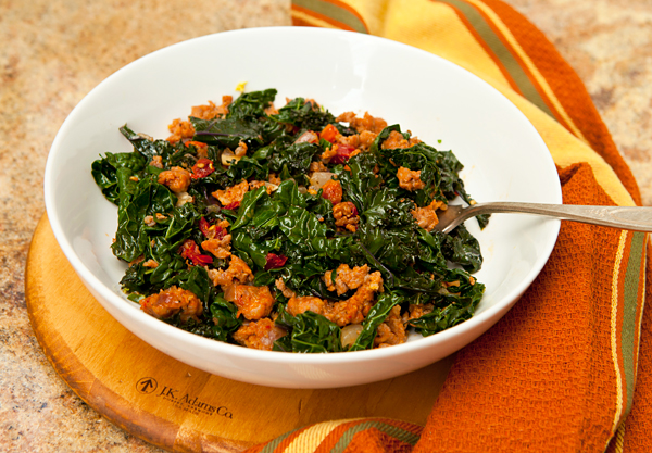 By adding sausage and sun-dried tomatoes to sauteed kale, you turn sauteed green into a main course!