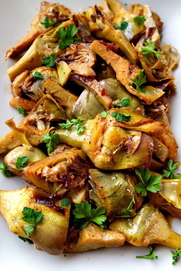 This simple method of cooking fresh artichokes really enhances their flavor.