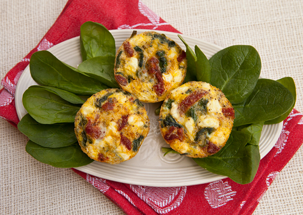 Delicious bite sized frittata studded with spinach, sun dried tomatoes and goat cheese are a great addition to any antipasti platter.