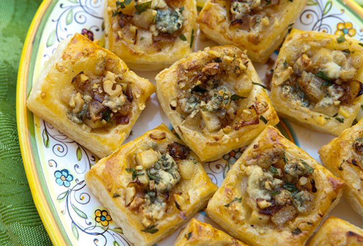 Puffed golden squares of pastry are topped with a mixture oftender pears, onions, and blue cheese in this quick and easy appetizer.
