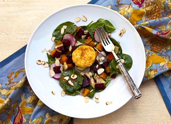Warm goat cheese coins top this sweet, roasted beet salad.