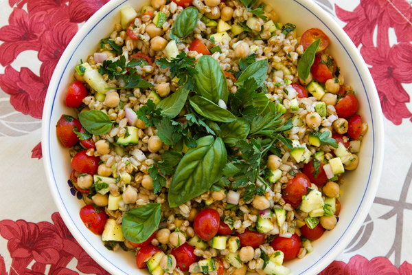 Summer veggies pair with nutty farro in this easy summer salad.