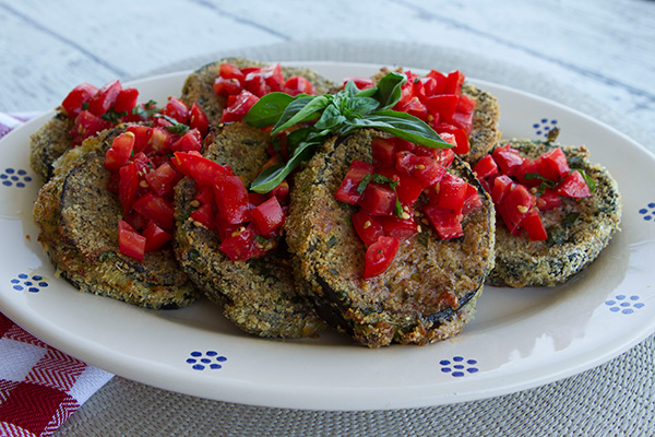 Tender slices of eggplant are breaded and fried until golden brown in this appetizer or veggie side dish.