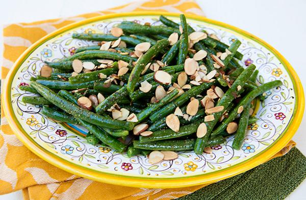 A vinbrant flavored dressing gives basic green beans new life.
