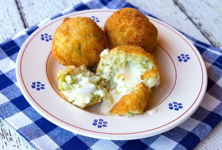 Asparagus flavored rice balls stuffed with taleggio cheese.