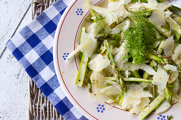 A raw salad combining asparagus and shaved fennel.