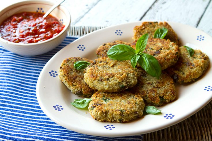 Tender eggplant is breaded and fried creating crisp, golden patties served with sauce.