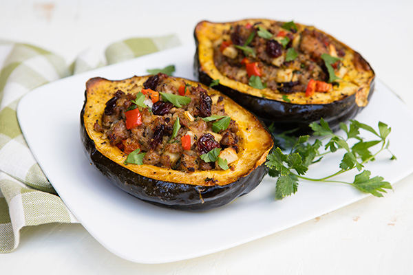 These tender acorn squash are stuffed with sausage and fruit in this tasty fall or winter dish.