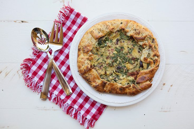 A rustic ricotta and artichoke tart that would be delicious year round.