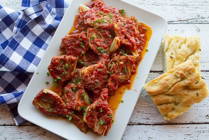 Braising artichokes in tomato sauce creates a meltingly veggie side dish.