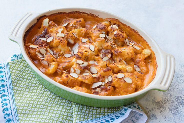 This unique recipe blankets tender cauliflower florets in a creamy tomato sauce.