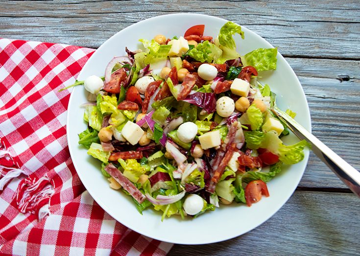 This salad has it all.....veggies, meat and cheese all tossed together is a vibrant dressing.