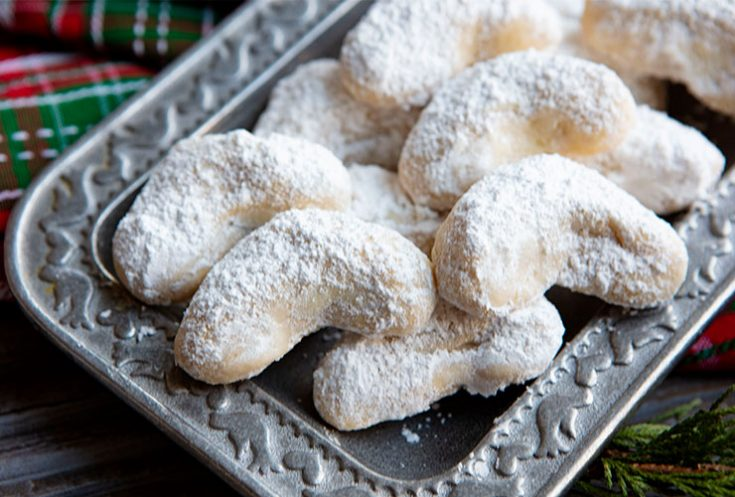 Tender, buttery cookies dusted in powdered sugar.