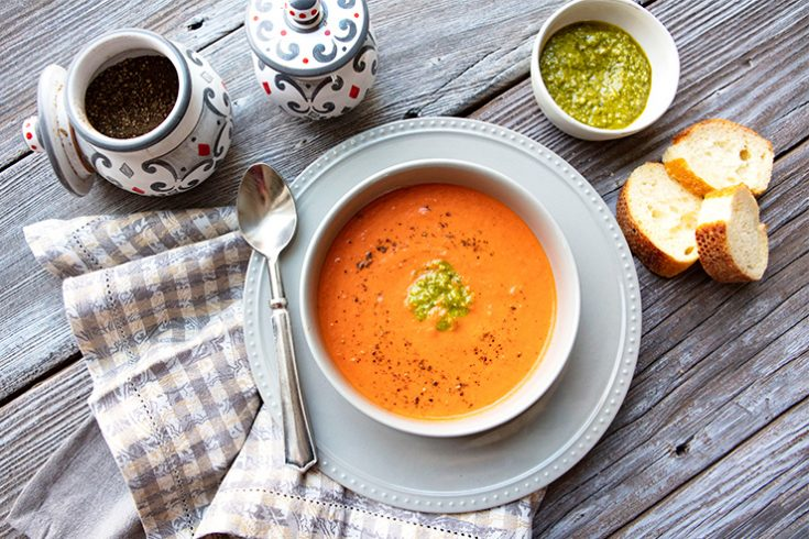 A creamy, satisfying tomato soup flavored with rosemary and basil.