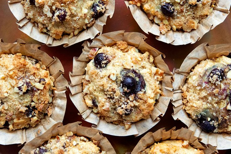Tasty, moist blueberry muffins made with whole grain flour and heart-healthy olive oil.