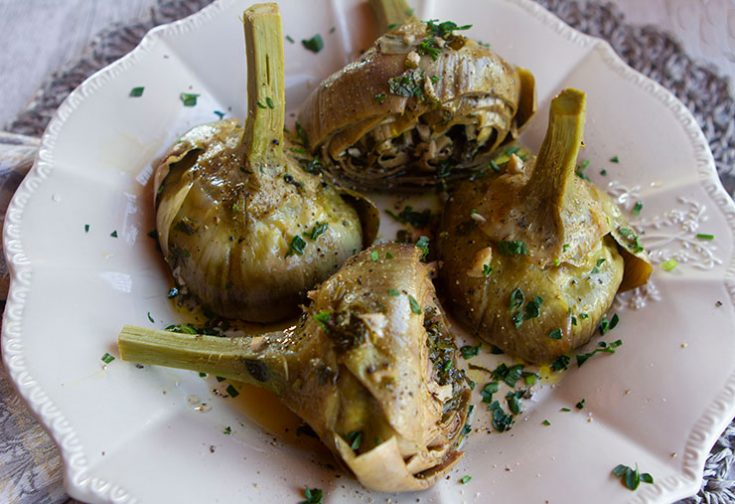 Tender globe artichokes are stuffed with an herb and garlic mixture and then gently braised in a blend of olive oil and white wine until tender.