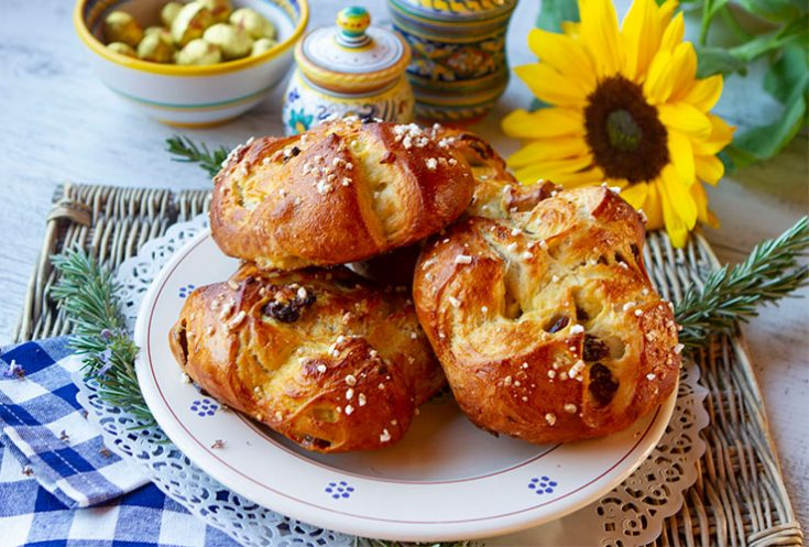 Lightly flavored with rosemary and raisins, these not too sweet Easter buns are a specialty in Tuscany.