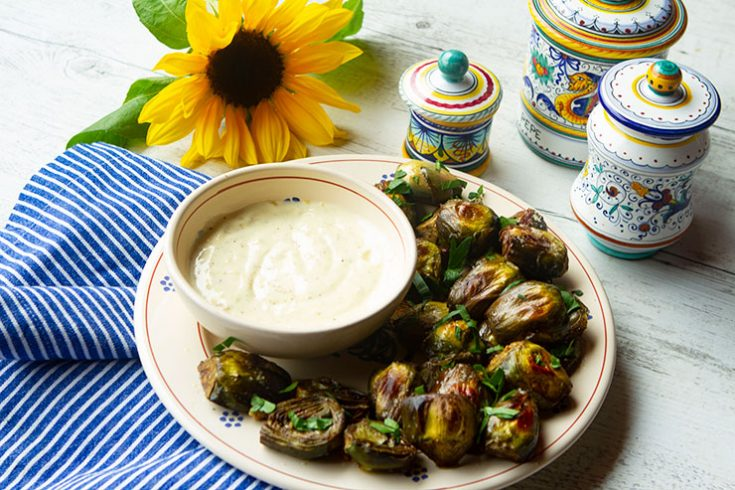 Roasting fresh spring artichokes enhances their flavor and brings out an earthy sweetness.