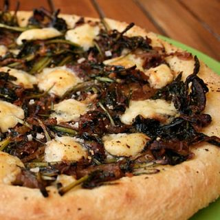 Dandelion Greens And Caramelized Onion Pizza