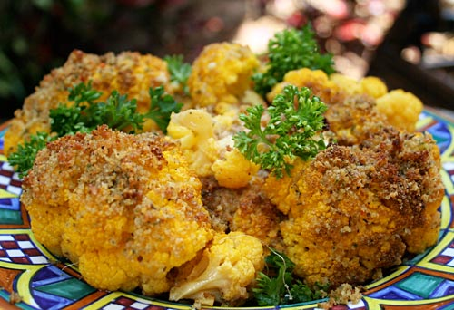 Tender oven roasted cauliflower gets a makeover with a golden brown crumb crust.