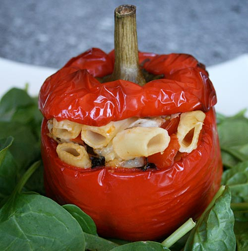 A light stuffing of pasta, tomatoes, and cheese creates a lighter version of stuffed peppers.
