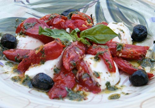Roasted tomatoes replace fresh ones when out of season in this Italian classic salad.