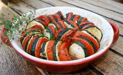 Zucchini and tomatoes are perfect partners in this dish as roasting both brings out their natural sweetness.