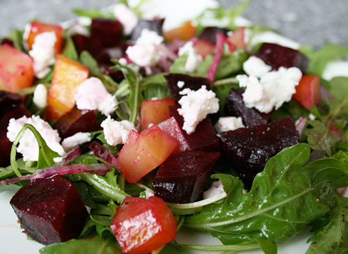 Roasted beets and goat cheese bring added interest to this tasty fall influenced salad.