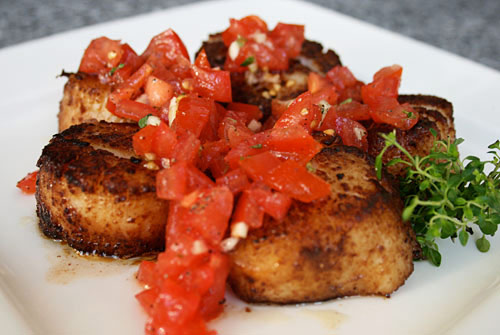 Sea scallops should have a golden brown sear on the outside, but be creamy and tender inside.