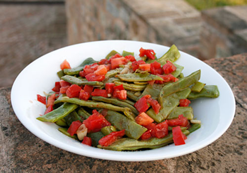A great side dish to make with garden fresh green beans and tomatoes.