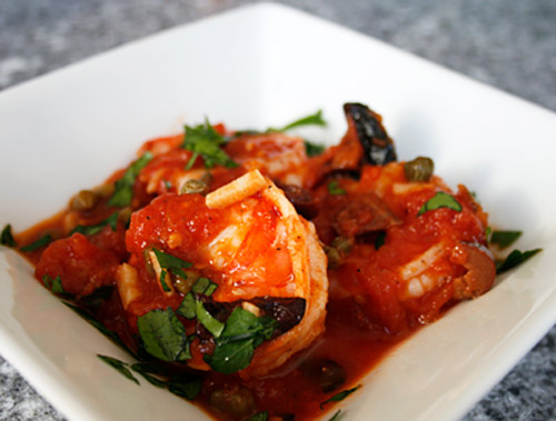 In this easy recipe, quickly cooked, tender shrimp are coated in a delicious tomato sauce which has been flavored with olives, capers, garlic and hot peppers.