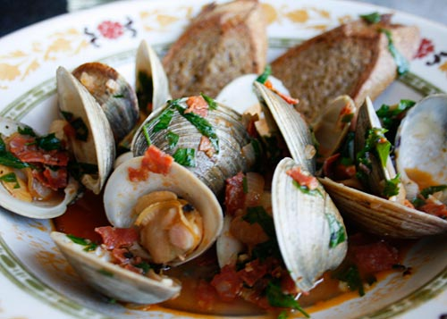 A little spicy salami adds a little kick to steamed clams.