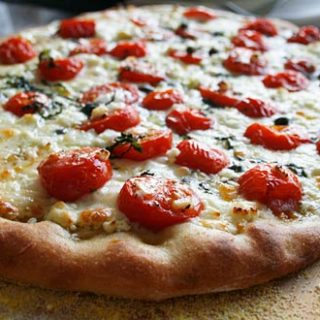 Pizza With Cherry Tomatoes And Goat Cheese