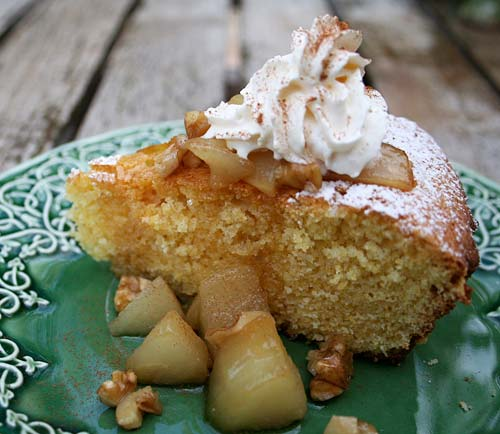 This rustic cake made with olive oil and cornmeal is lovely topped with poached fruit.
