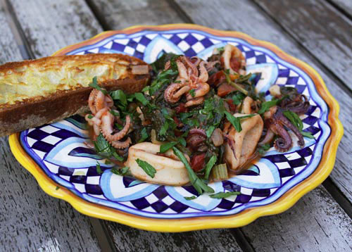 Squid, slowly cooked in tomato sauce makes a tasty appetizer or light entree.